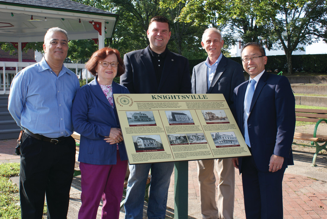 NEW SIGNAGE: Last week, Mayor Allan Fung joined community members to mark the completion of the second phase of the growing Cranston Discovery Network, which has brought additional historical markers in the Knightsville neighborhood, Oaklawn Library, Sprague Mansion, Cranston Print Works, St. Anne's Church and the Joy Homestead. With the Mayor at the Knightsville reveal were (l-r) Ed Garcia (Director of Cranston Libraries), Sandra Moyer (President of the Cranston Historical Society), Chris Paplauskas (Ward 5 City Councilman) and Chris Barnett (Senior Public Affairs Officer from the RI Foundation). More historical markers/signage are expected in the near future.