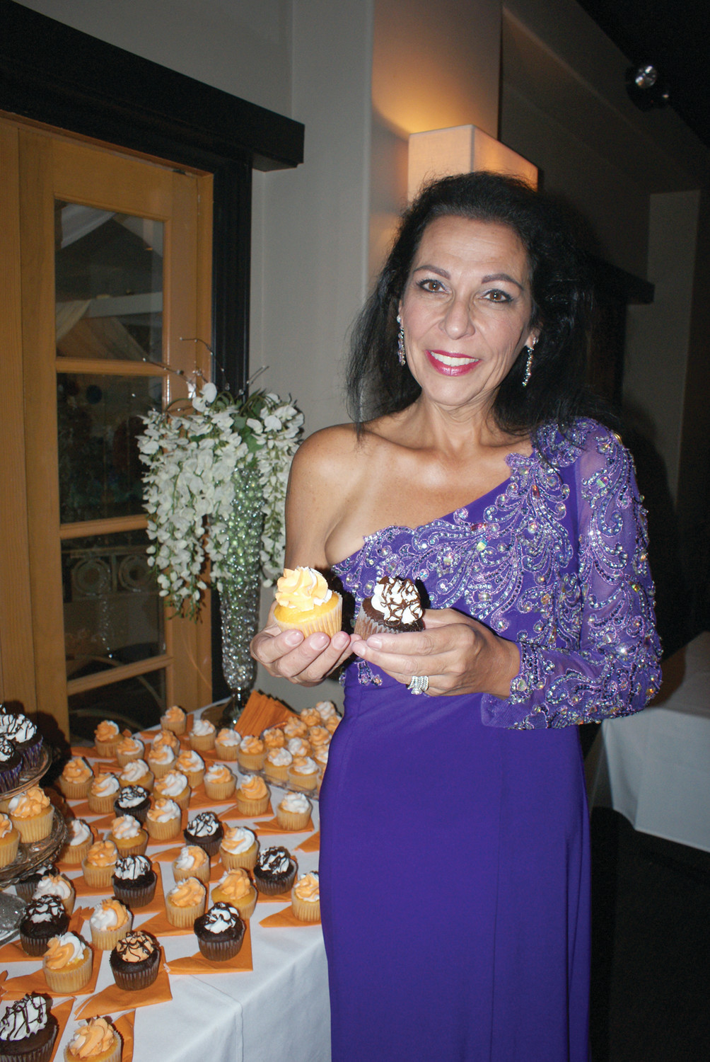 HOW SWEET IT IS: Spain Restaurant in Cranston will host the 2nd Annual Eric Medeiros Memorial Foundation Fundraising Gala on Sept. 4. Organized by Anna Casador who is pictured last year with her homemade cupcakes at the first gala, the event is in memory of her son Eric Medeiros who suffered a traumatic brain injury during a car crash in 2007. This year, Casador, will also be providing her sweet treats for dessert at the event.