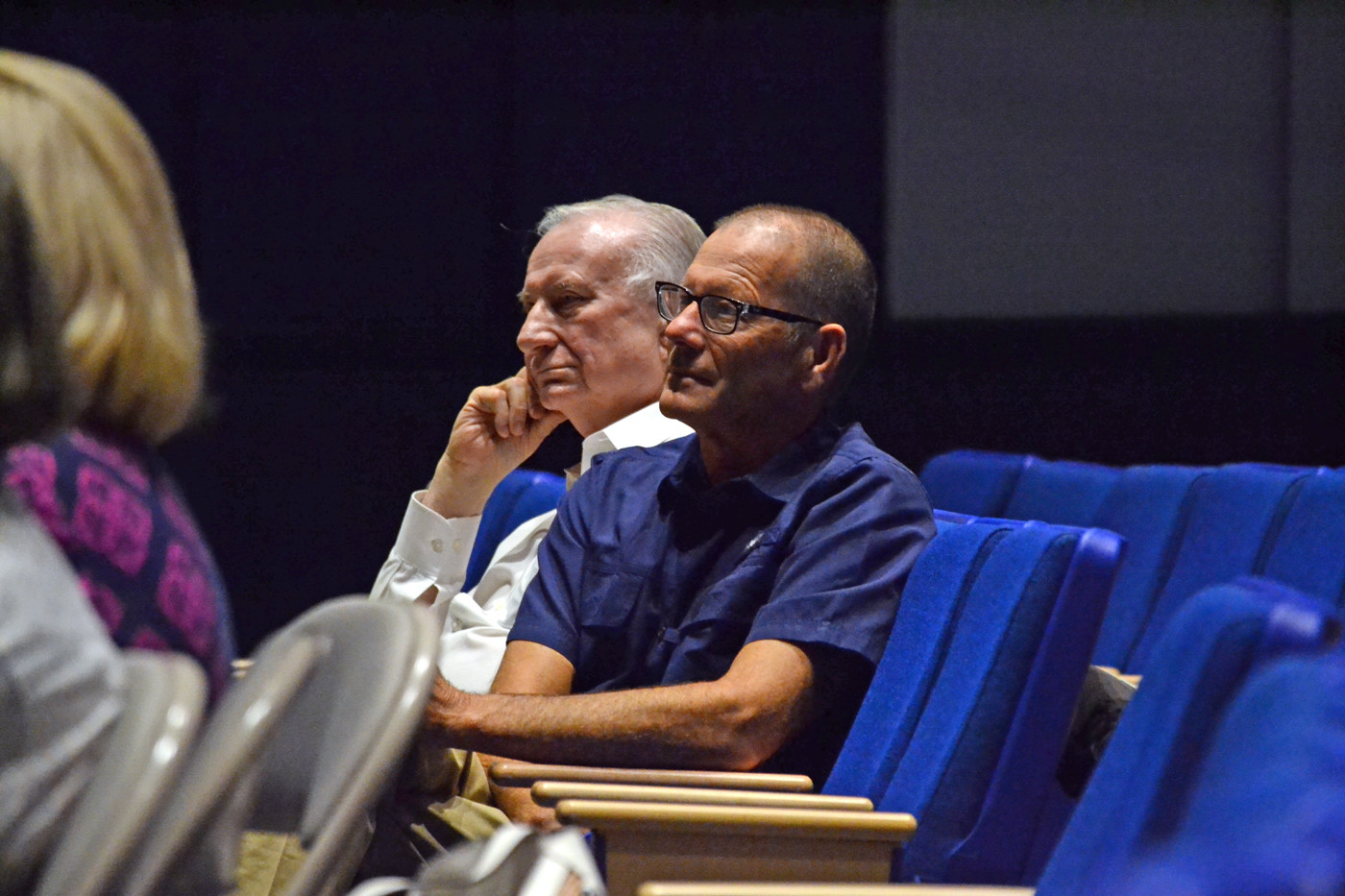 BEHIND THE NUMBERS: Thomas Conlon (left) and Robert Hicks seated at the Tuesday night meeting of the School Committee prior to Hicks giving his report on the school department's program audit.