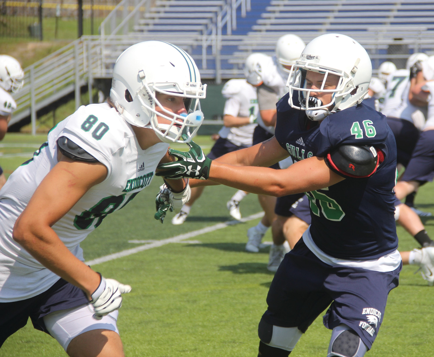 TIGHT COVERAGE: Warwick native and Endicott defensive back  Josh Morin covers a receiver during a training camp practice this summer.