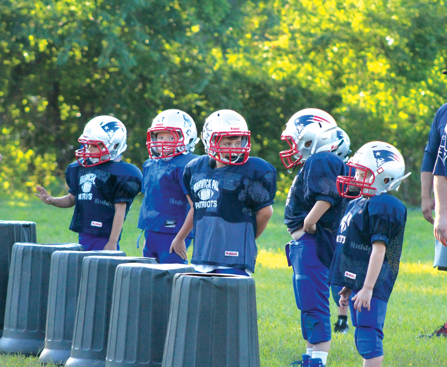 COUNTDOWN TO KICKOFF: Players from the Warwick PAL youth football teams practice during the league's preseason camp this summer.