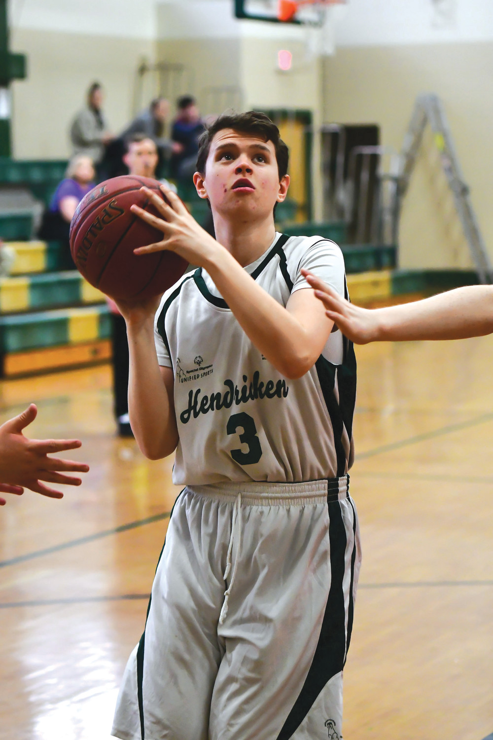 STANDING TOGETHER: Bishop Hendricken unified basketball player Josh  Tucker goes up for a shot during the 2018 season.