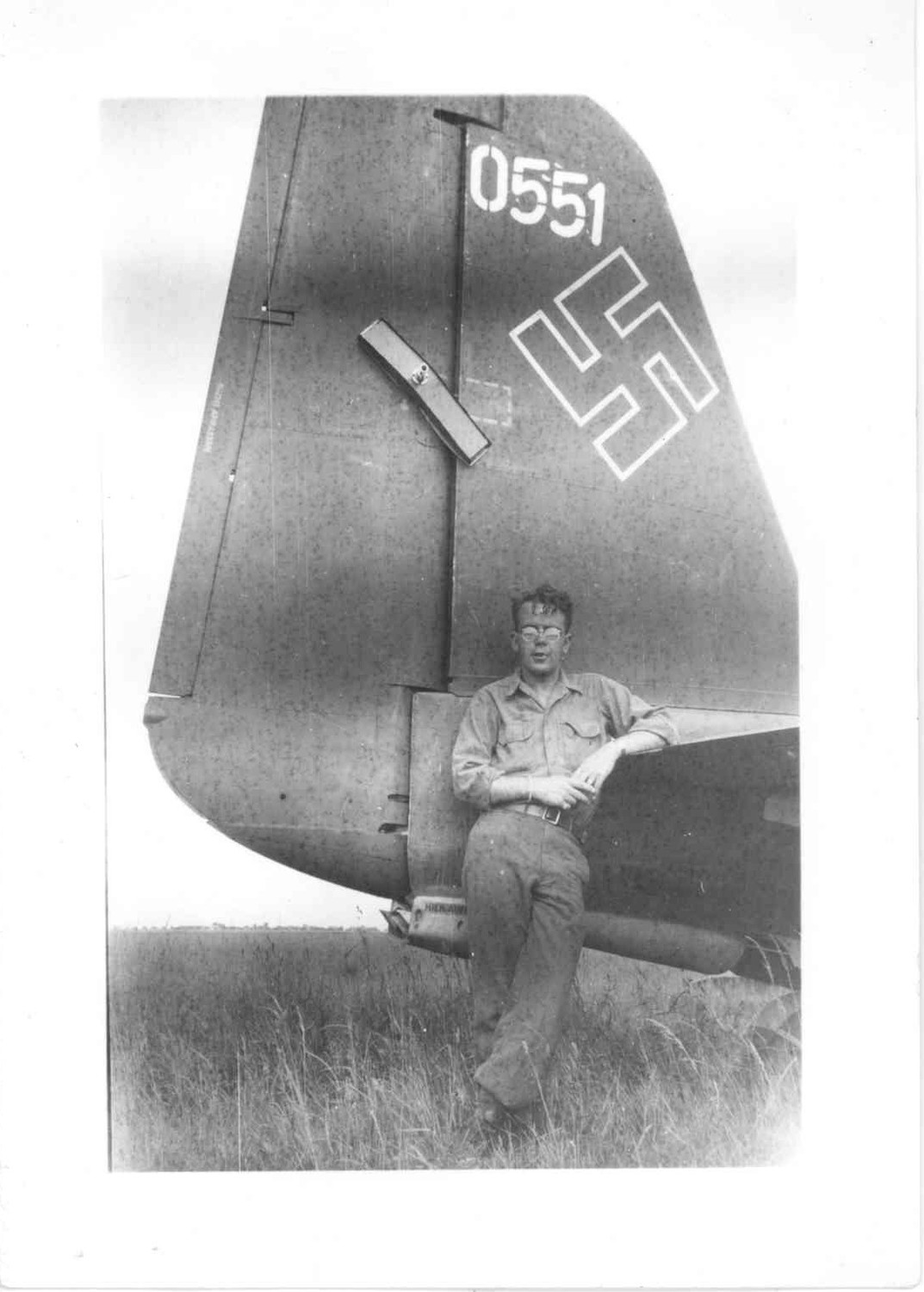 Hayes poses next to a Nazi Luftwaffe airplane that had been grounded.