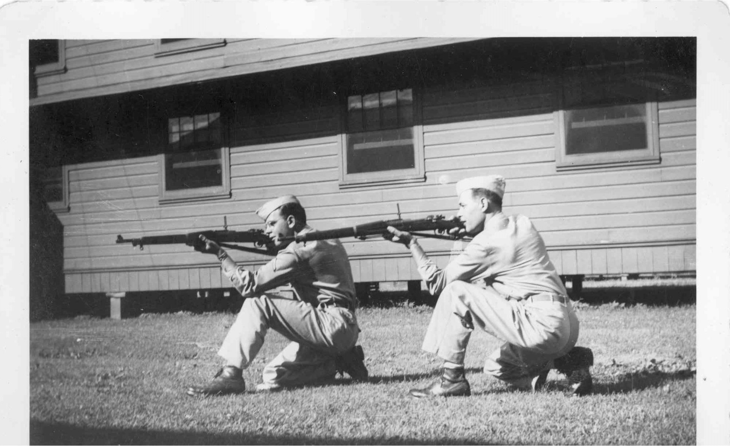 Hayes Jr. and a fellow soldier training prior to deployment, firing rifles.