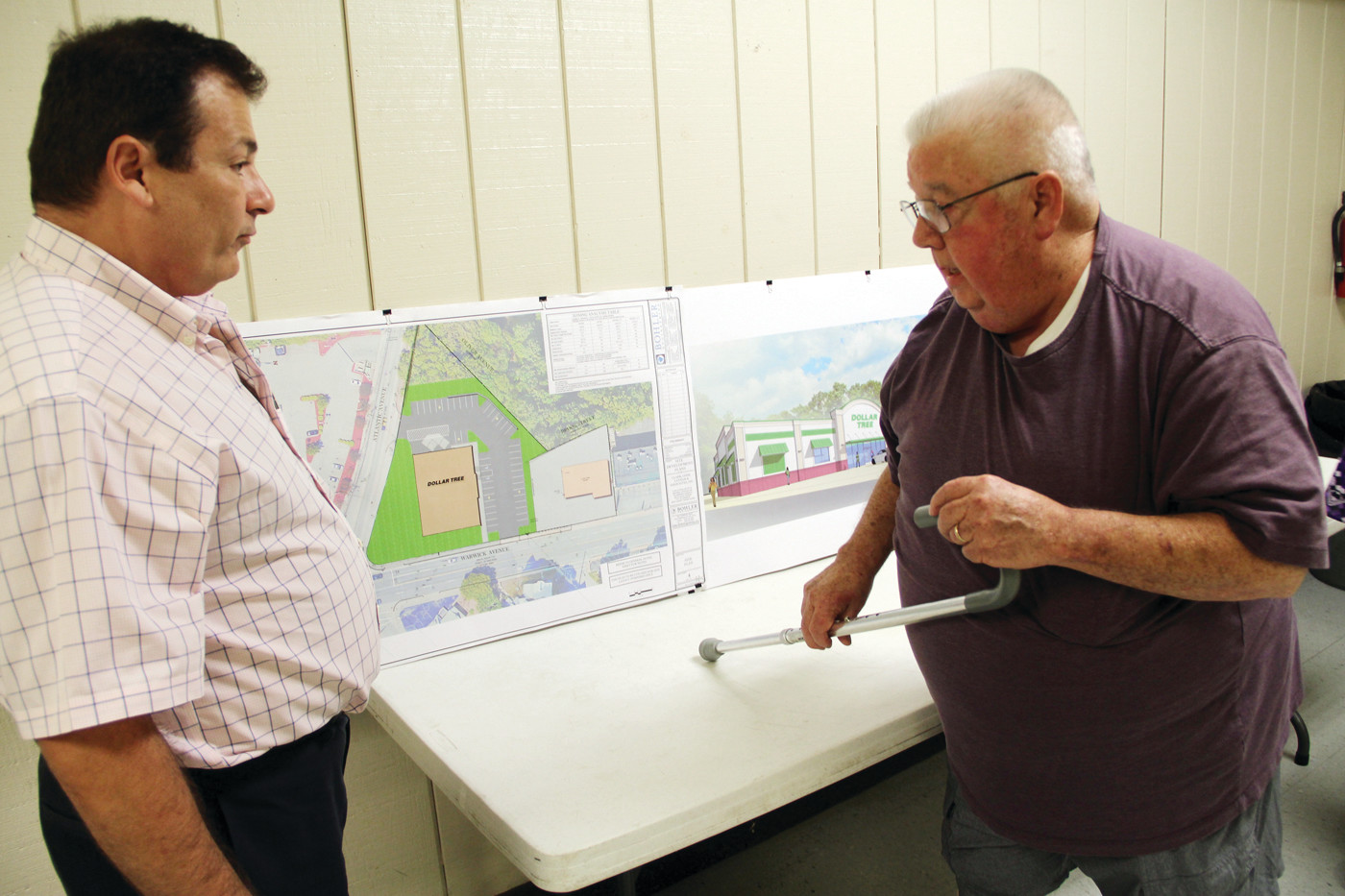 QUESTIONS ANSWERED: Attorney K. Joseph Shekarchi, who presents developers of a proposed Dollar Tree store and James King, a neighbor to the development, review plans at an informational meeting held last week at the Warwick Firefighters Association hall.