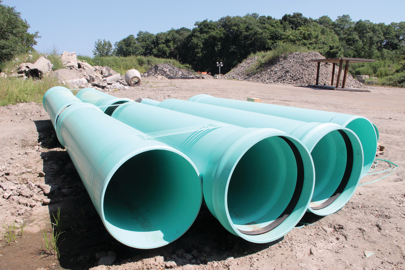 WHAT'S NEEDED: Sections of replacement pipe are close to the site of two sewer pipe breaks that on Aug. 28 resulted in the release of 300,000 gallons of waste water in the vicinity of Buckeye Brook.