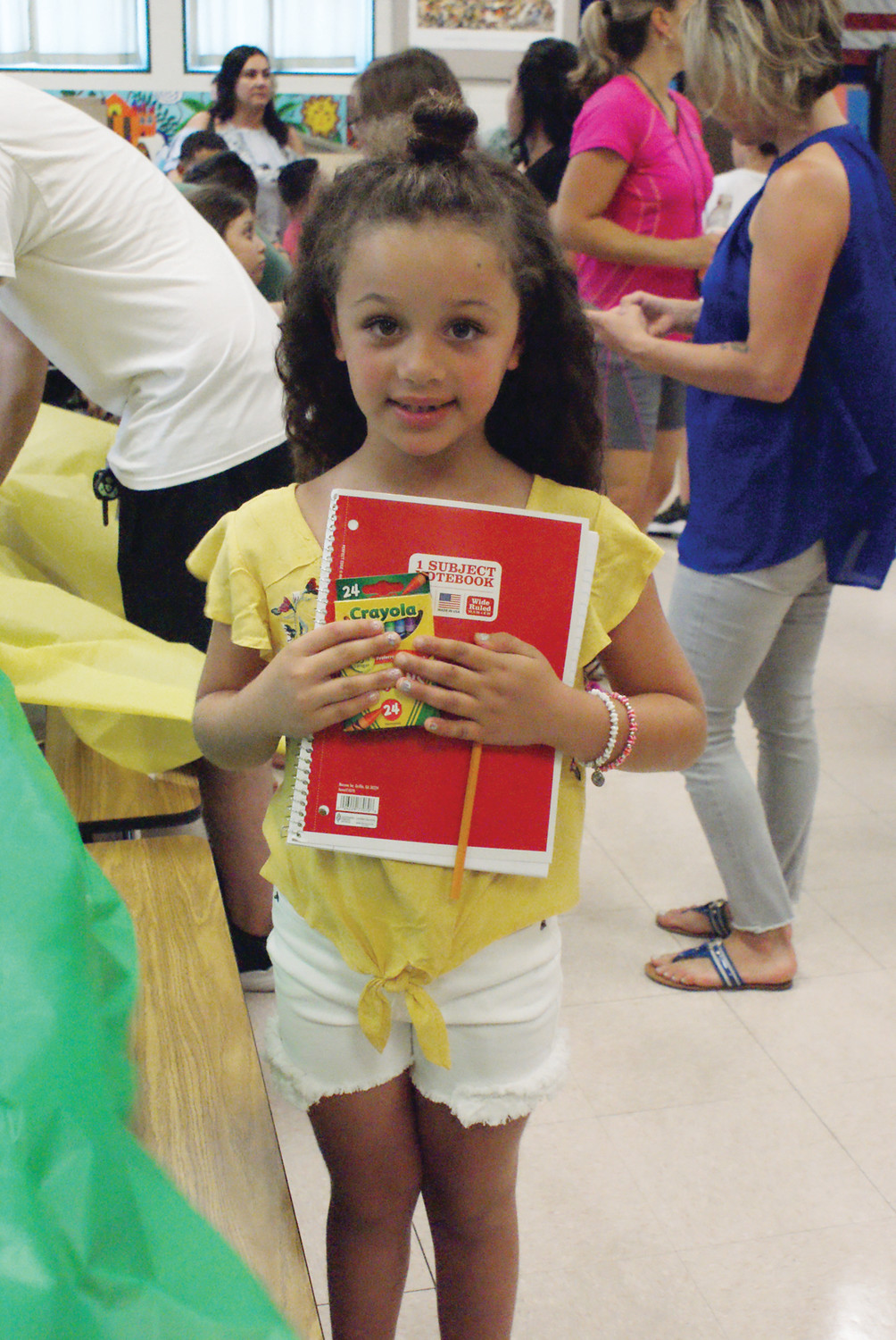 SCHOOL SUPPLIES: Holding her new school supplies at the Chester Barrows Meet & Greet was Starrla Freu, age 6 who entered the first grade this year.