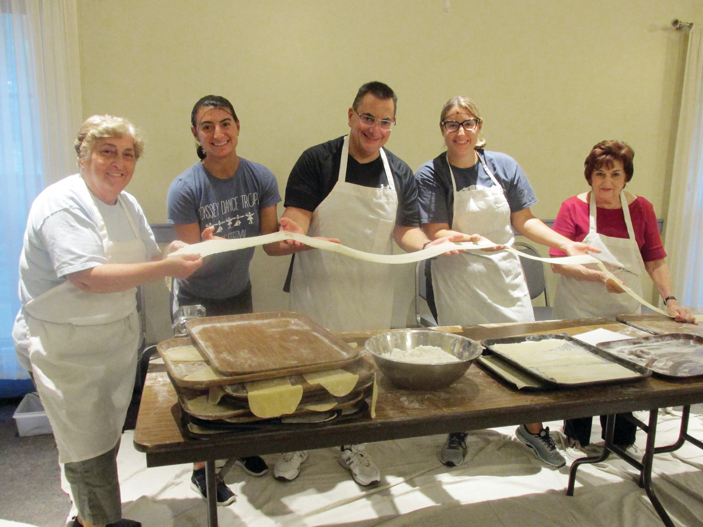 DOUGH DUTY: Among those many volunteers who helped make the ever-popular diples for this weekend's Cranston Greek Festival are (from left) Koula Rougas, Eleni Grammas, Kosta Grammas, Elizabeth Grammas and Angela Provost.