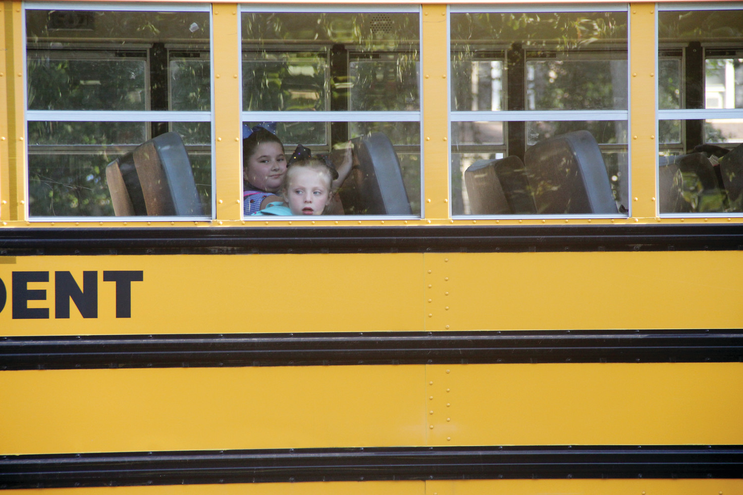 NEW FOR SOME: Students, some who went to Randall Holden School last year, look curiously as their bus arrives at Sherman School Tuesday morning.