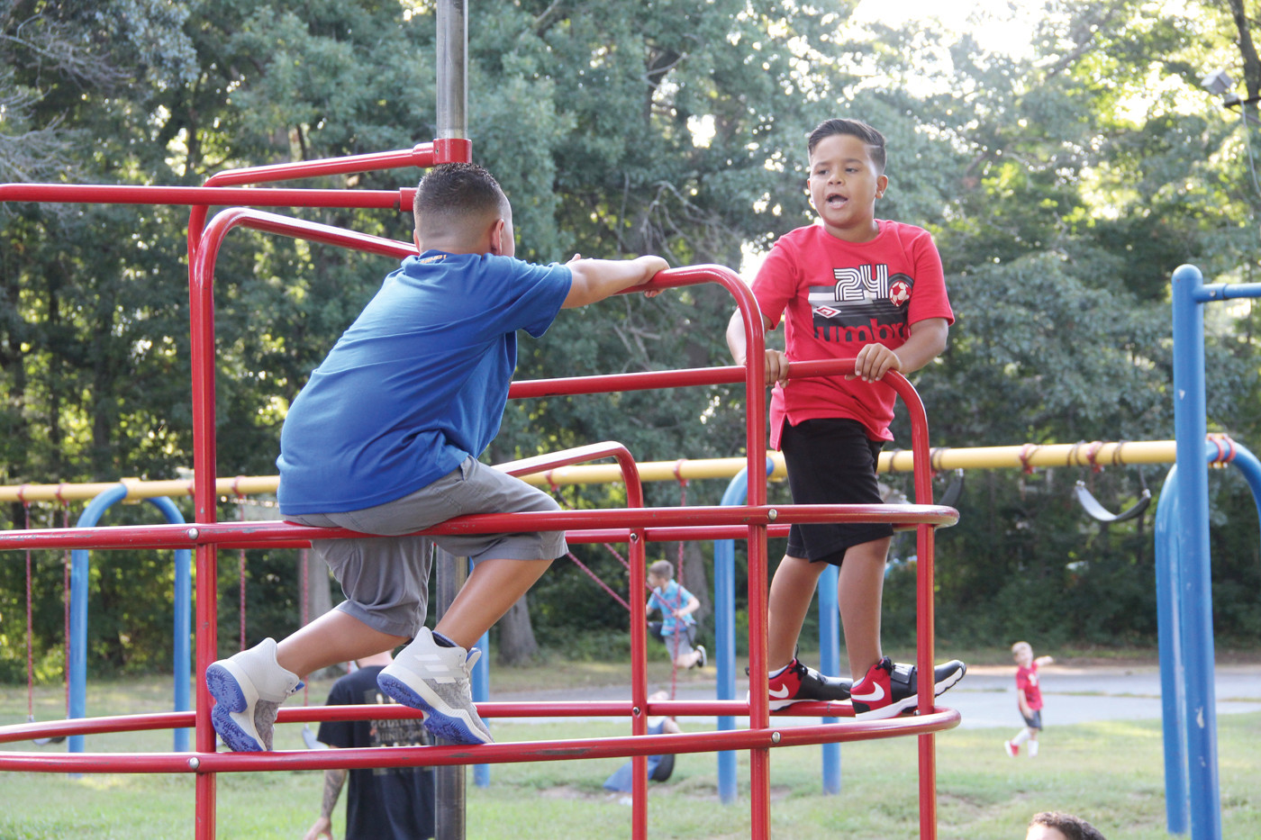 NEVER TOO HOT: Sherman students took to the jungle gym as they waited for doors to open.