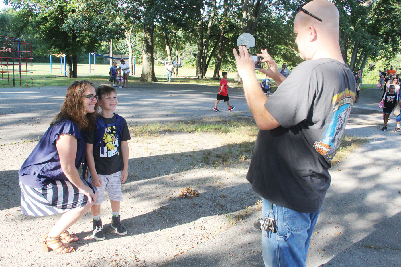FIRST DAY MEMORIES: Chip Wardyga snaps a photo of his wife, Bethany, and son Jacob on opening day at Sherman School.