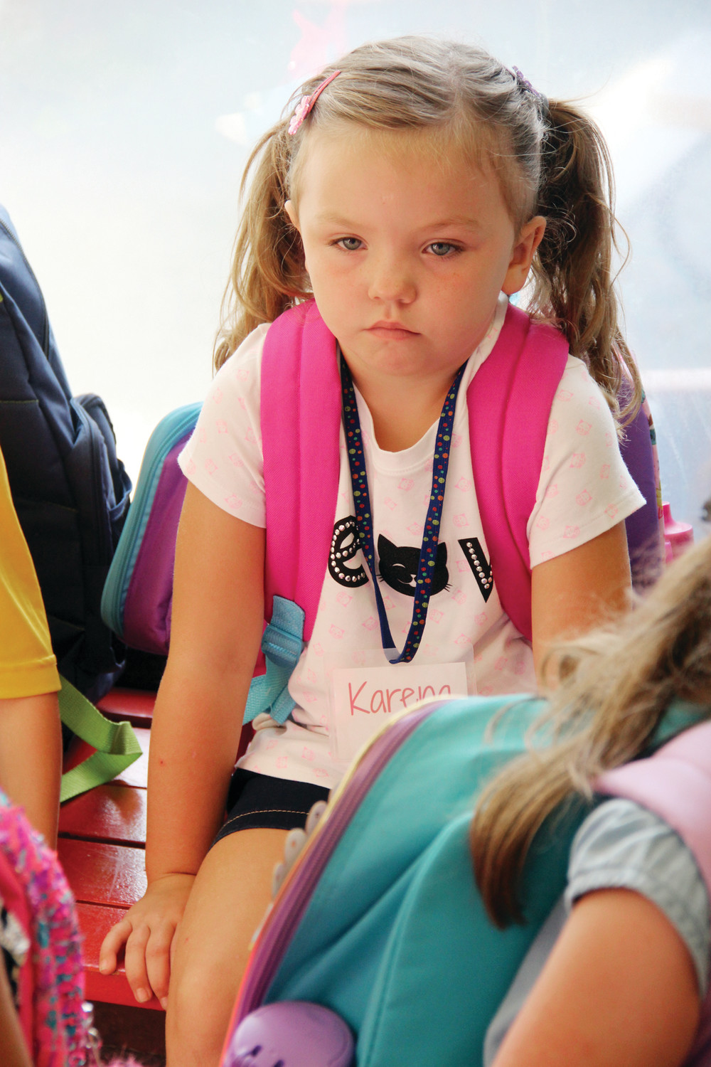 BRAVE FACE: Kindergartener Karena Stephenson waits for class assignment as she waits in the Sherman School hallway