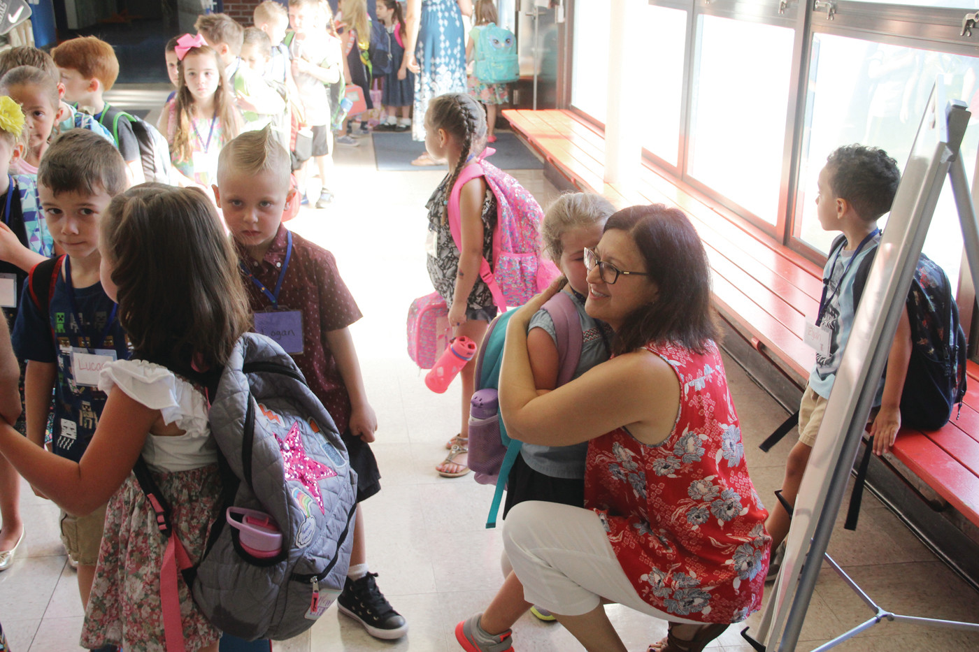IT'S ALL BETTER NOW: In this sequence, Sherman School teacher aid Amy Harnedy consoles a tearful Emma Kaplan and, after a comforting hug, leads her to her classroom.