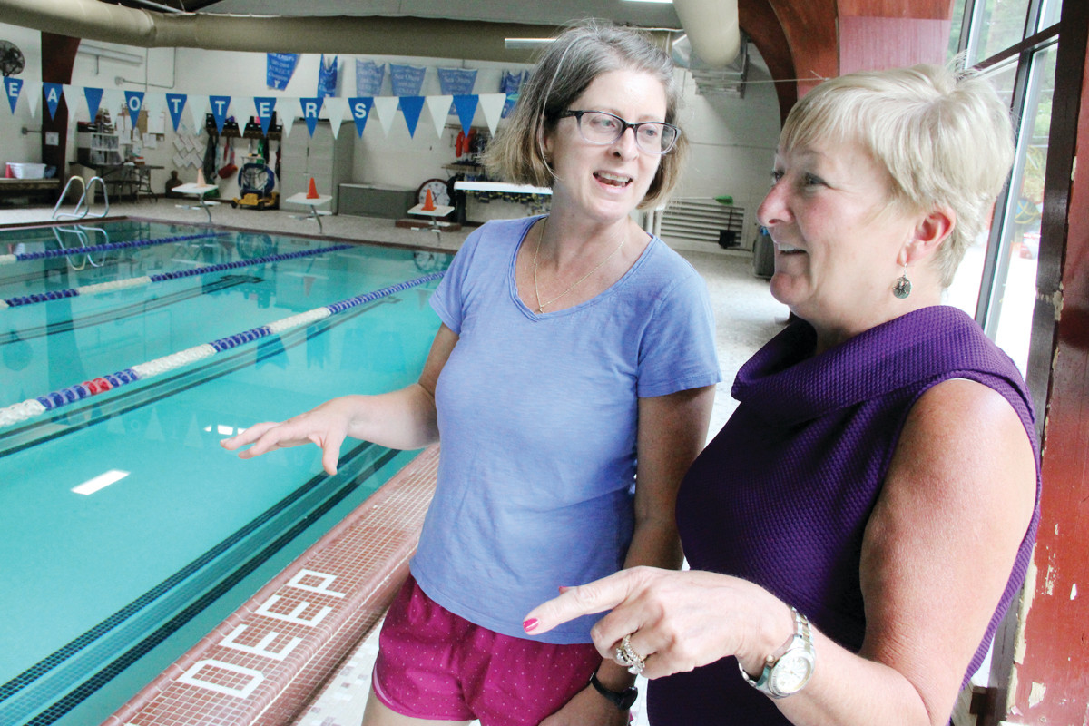 FOR SWIMMING LESSONS: Elizabeth Brosnan, sister of Mary K. Preston who died in a water-related accident, and Julie Casimiro, Y director, talk about the Oct. 8 fun run/walk to raise $10,000 for a Y swim lesson fund.
