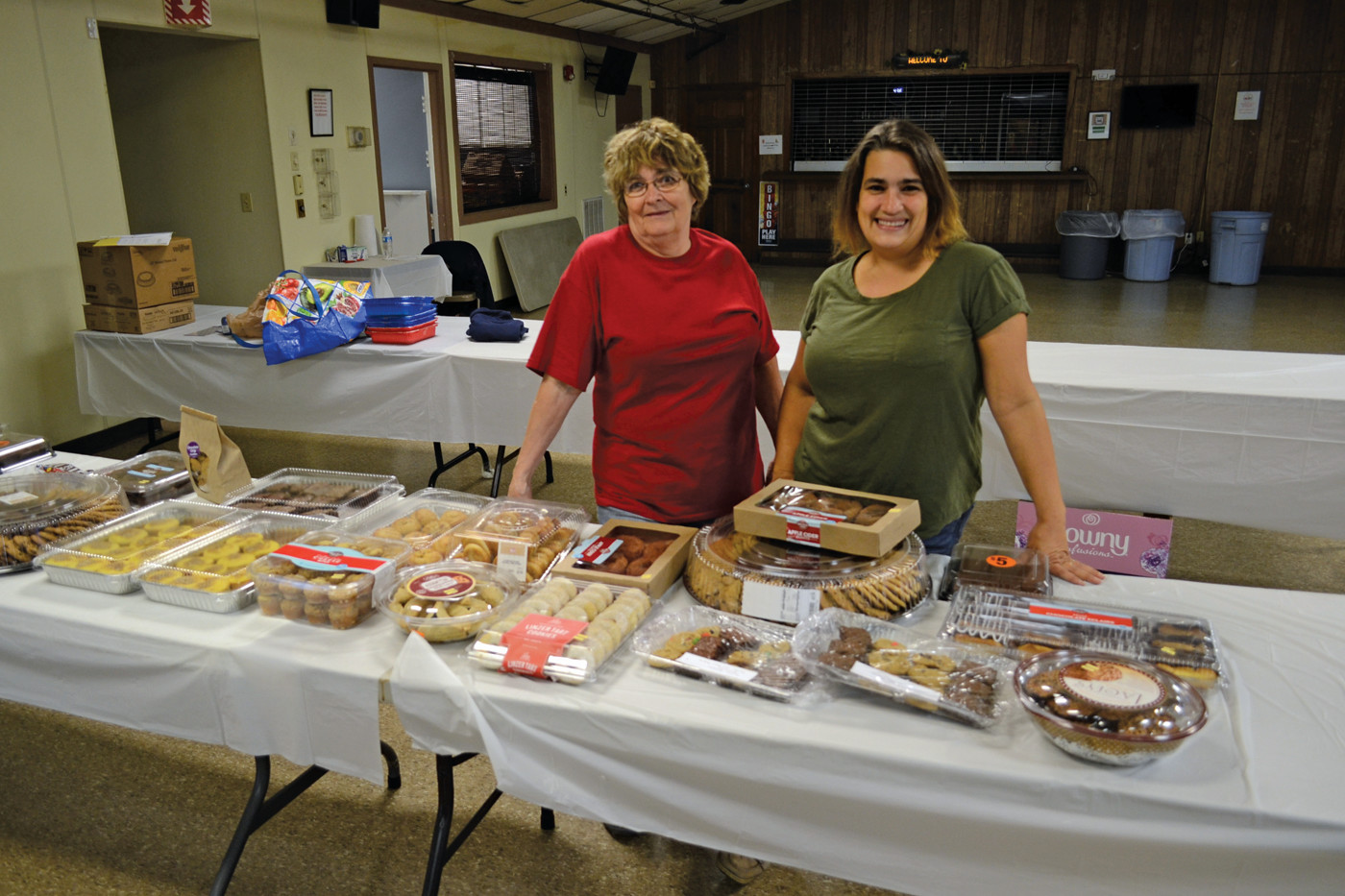 MAKING A DIFFERENCE: Gwen Maccarone (right) and her mother, Gloria Zeoli, were at the Shields Post on West Shore Road manning the donations of various sweet treats for first responders on Monday afternoon.