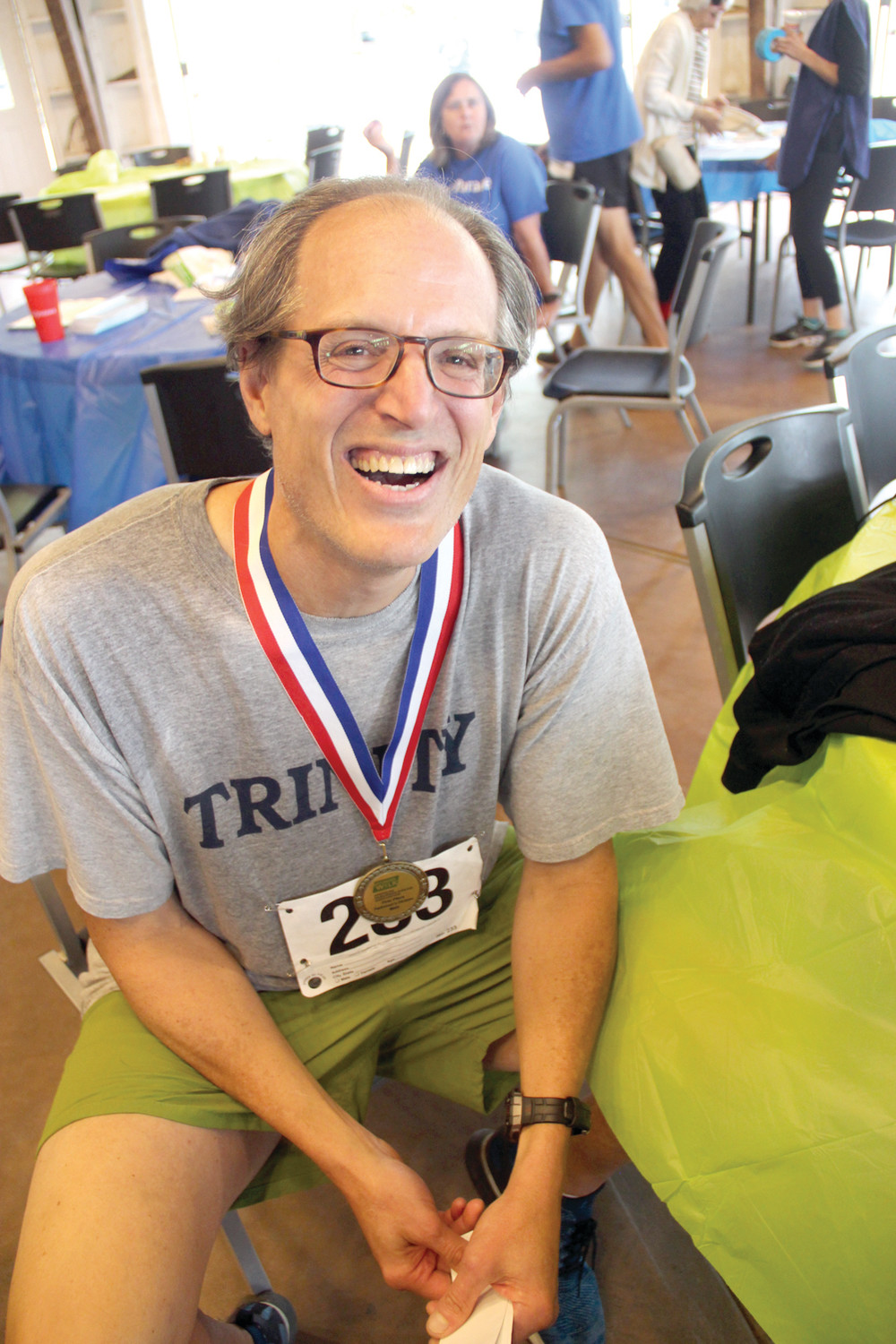 KEEPING ACTIVE: Jeffrey Bartsch, who has Parkinson's, and the first place medal he won as a runner in Saturday's event.