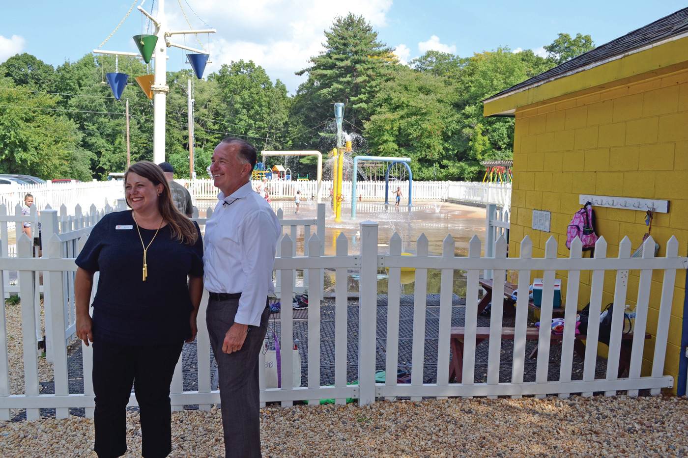 PARK PURVEYORS: Kate Messier, vice president of program quality and Steven O'Donnell, CEO of the Greater Providence YMCA, spoke about why they opened their spray park to the general public last week during a scorching day in the state.