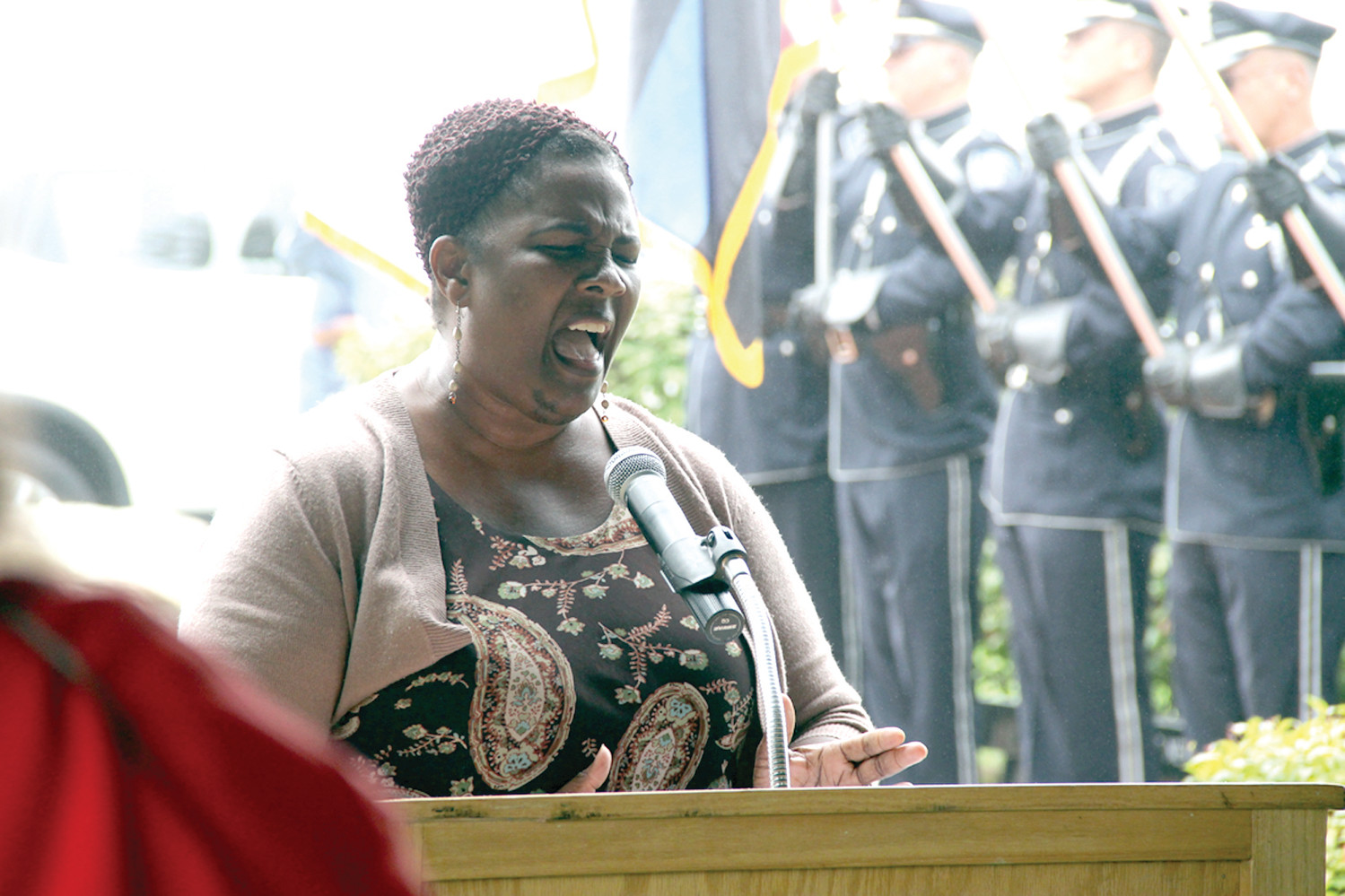 POWERFUL RENDITION: Cheryl Albright performed the National Anthem to open the ceremony and later God Bless America.