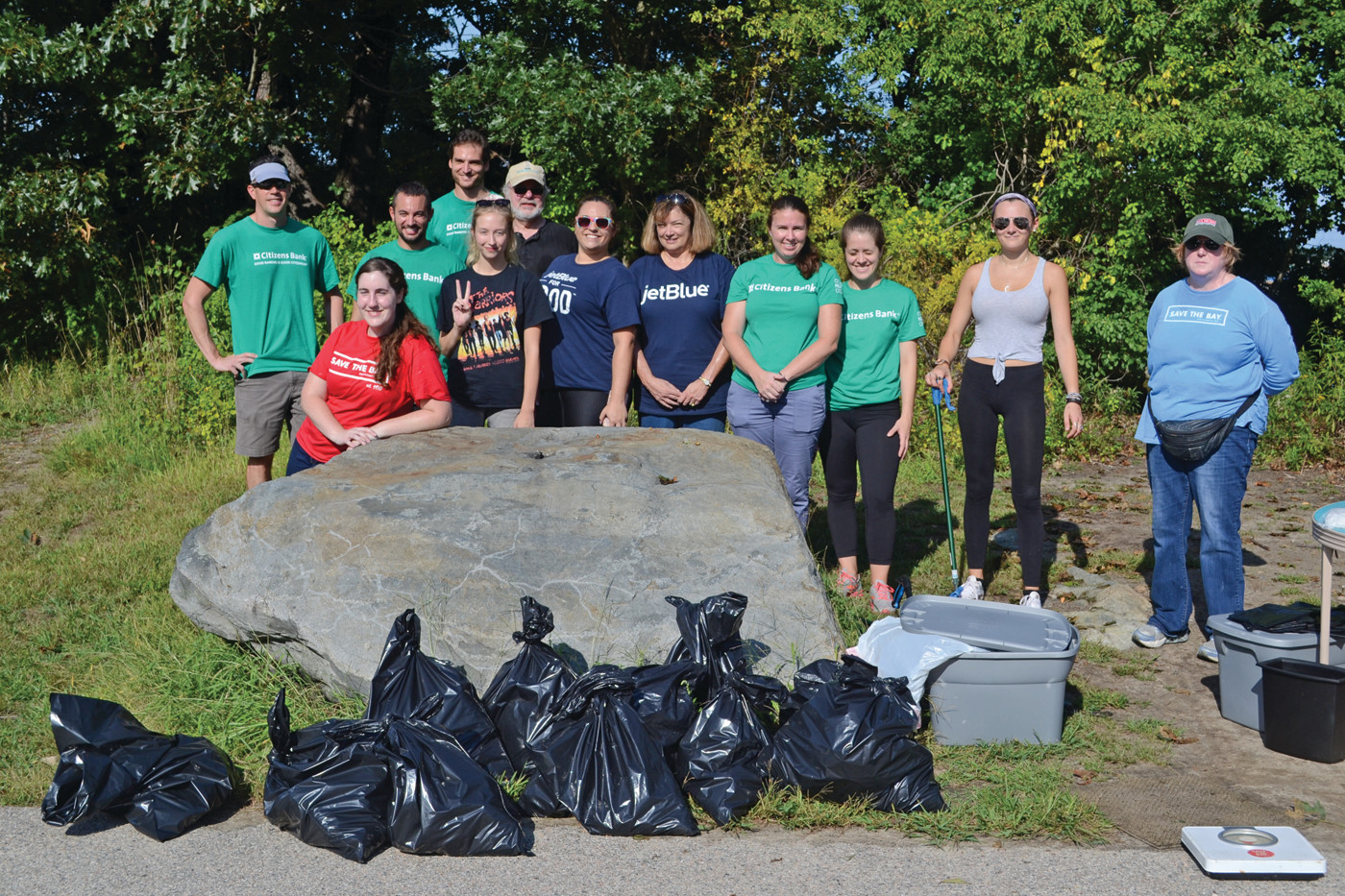 TEAMWORK: In just two hours, 12 volunteers helped remove 86 pounds of trash from Salter Grove. Volunteers came from Save the Bay, Citizens Bank, Jet Blue and elsewhere in the city.