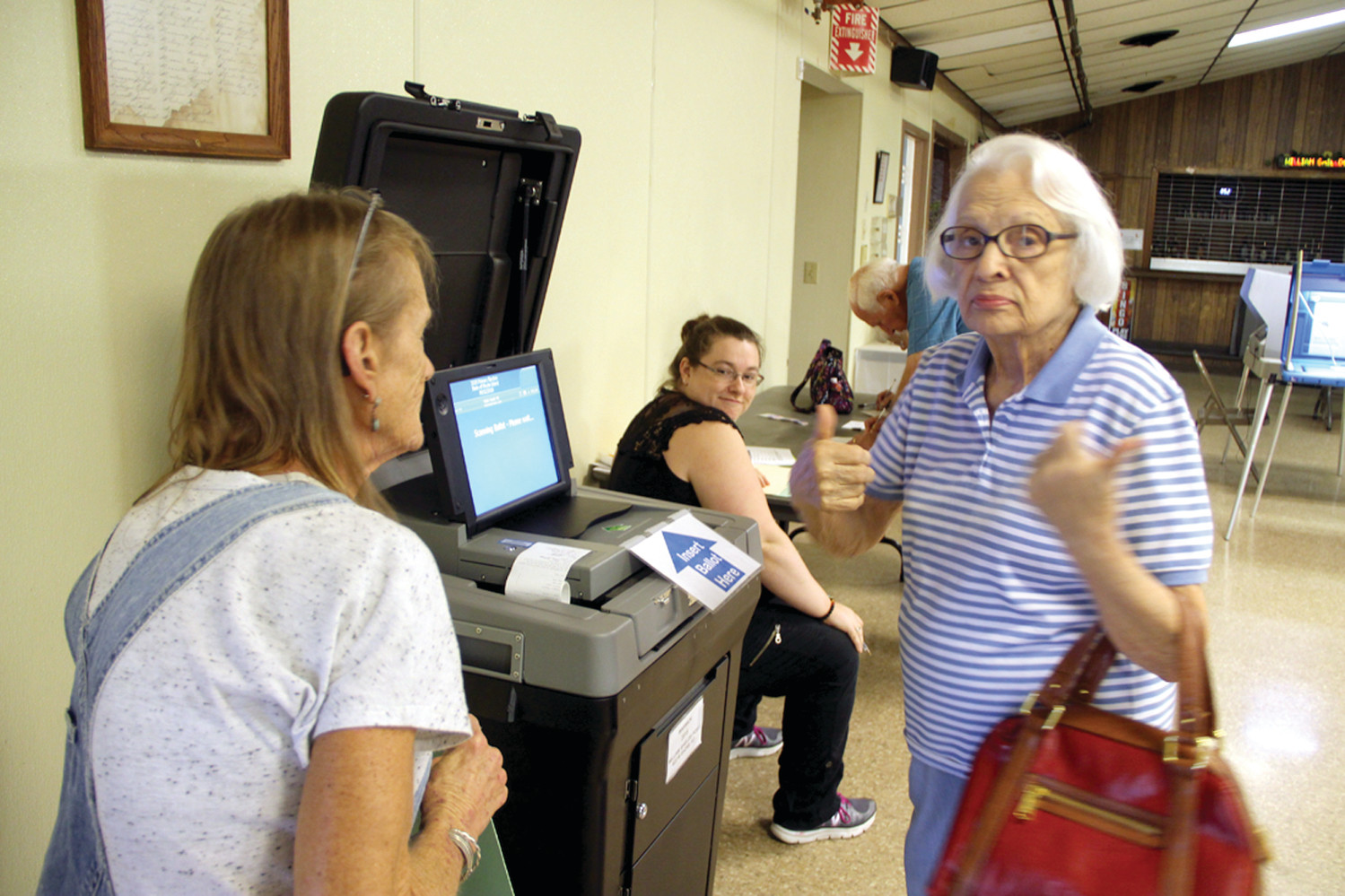 THUMBS UP: Ann Galloghy gives a thumbs up after casting her ballot at the William Shields Post poll Wednesday morning.