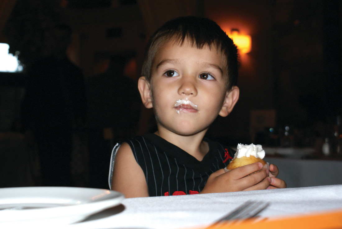 YOUNGEST GUEST: Enjoying a cupcake baked by Anna Casador was Donovan Ballou, age 2, during the Eric Medeiros Memorial Foundation Gala.