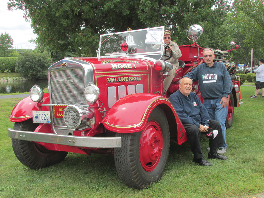 THORNTON TRIO: As Albert Aurecchia, 90, sits behind the wheel of this 1936 Maxum Fire Truck, his fellow and one-time Thornton Volunteers Alan Zambarano and John Marrocco enjoy the moment during Sunday's super show inside War Memorial Park.