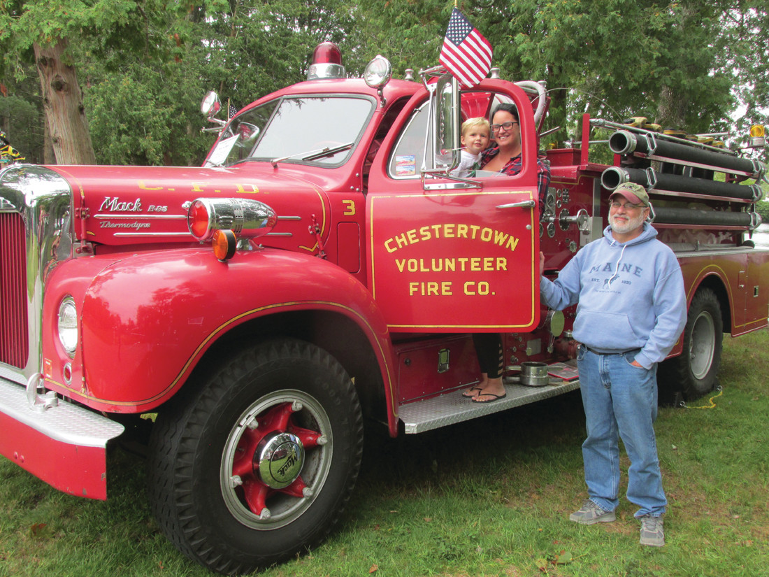 MIGHTY MOMENT: Lucas Proulx, 3, got his first-ever view inside this 1957 Mack fire truck that owned by Mike from Westerly, with assistance from his mother Kristin Proulx during Sunday's show.