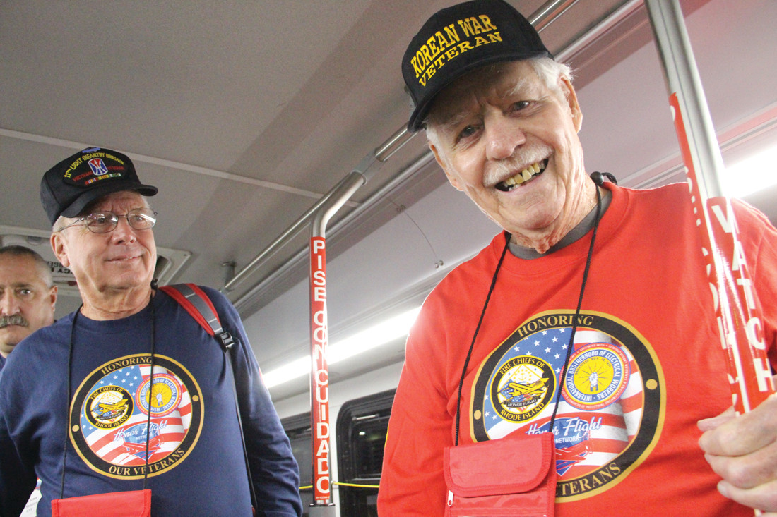 ALL ABOUT VETERANS: Dave Sayles served as the guardian for veteran Walter Kimball of Westerly, who actively works with the Disabled American War Veterans. Veterans and their guardians assembled at Station 8 in Warwick next to Ann & Hope before boarding buses at 5 a.m. to be escorted to Green Airport.