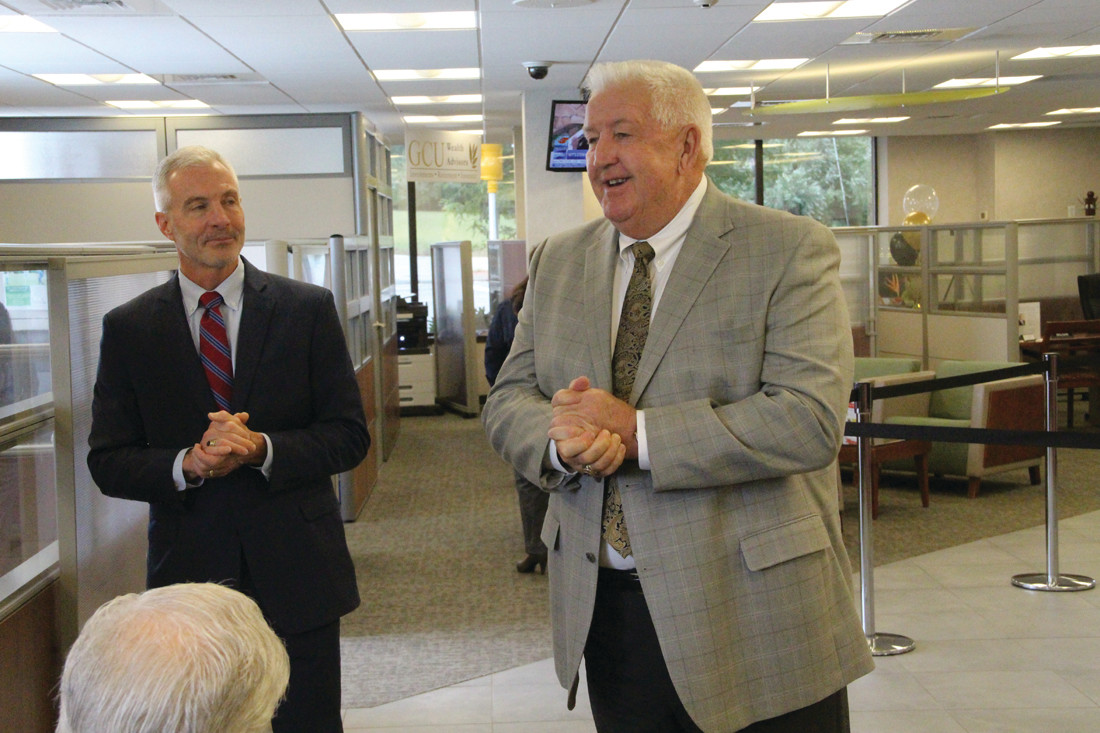 WITH PLANS TO GROW: Greenwood Credit Union President Frederick Reinhardt (left) and board chairman Thomas Ahern outlined plans for the operations center to be built across the street from the retail office on Post Road.
