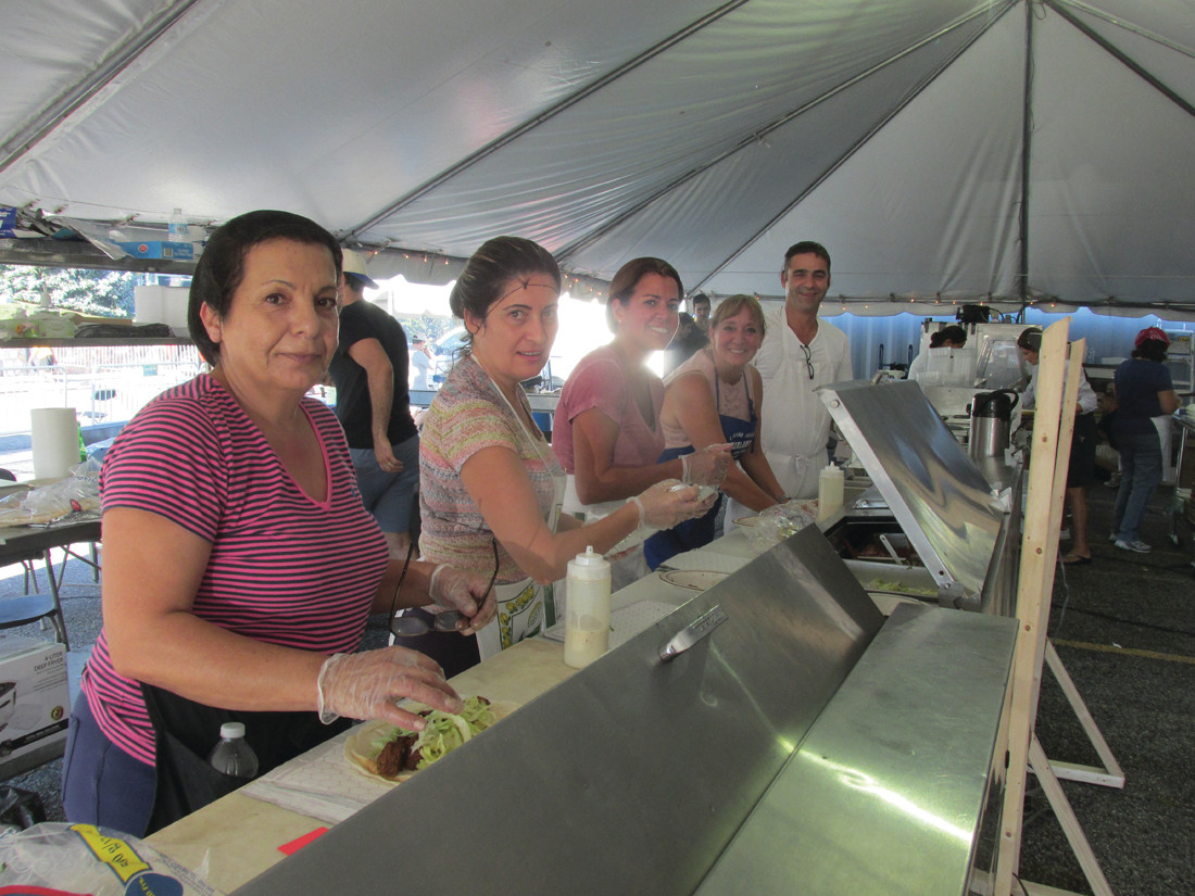 VALUABLE VOLUNTEERS: Five of the reasons behind the success of last weekend's 5th Annual Taste of Lebanese Food were because of the five people above who worked three straight days and nights making super sandwiches and other foods.