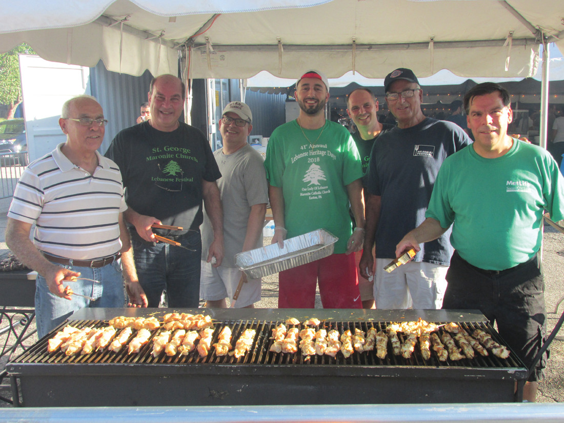 GRILL GANG: St. George Maronite parishioners like Mike Wakim, Joe Salem Michael Saker, Tony Simon, David Thomas and Greg Giarusso took turns grilling chicken and beef kabobs that were again a huge hit during last weekend's Taste of Lebanon in Cranston.
