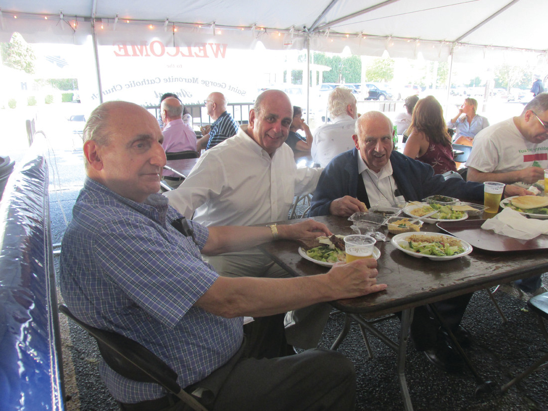 FAMILY FUN: Warwick Mayor Joseph J. Solomon (second left) enjoys last Weekend's Taste of Lebanese Food with a friend and his uncle, former RI State Treasurer Anthony Joseph Solomon (right).