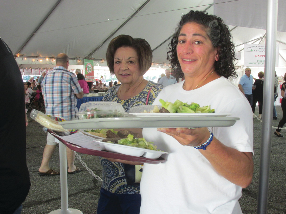 PALATE PLEASERS: Scenes like this were commonplace throughout last weekend during the 5th Annual Taste of Lebanese Food presented by the proud parishioners at St. George Maronite Roman Catholic Church in Cranston.