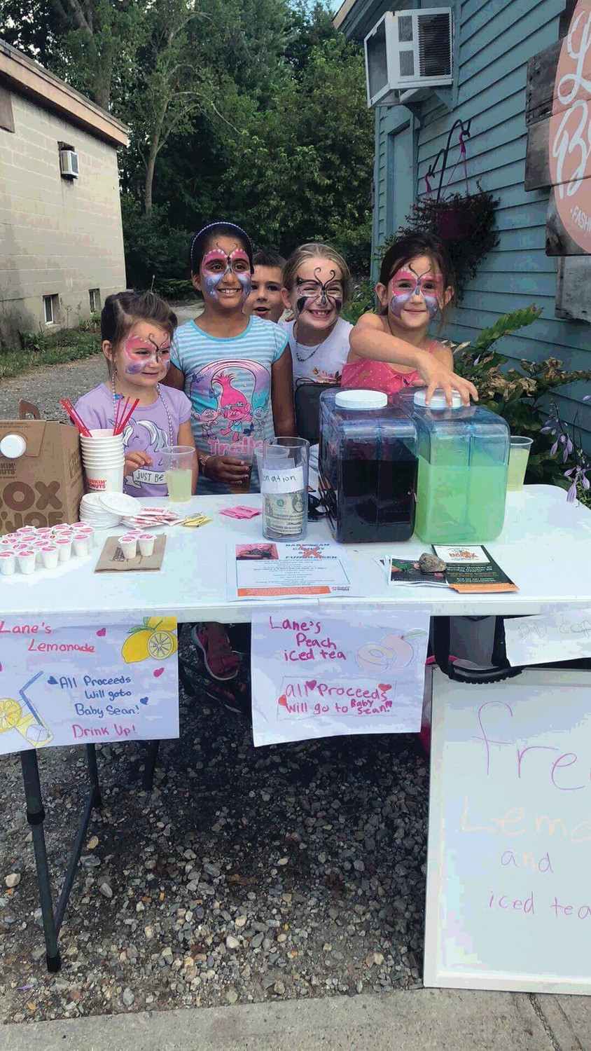LEMONADE STAND: Pictured is the Lane's Lemonade Stand and Peach Iced Tea that was set up during the fundraiser event in the village Saturday. All proceeds went to Baby Sean.