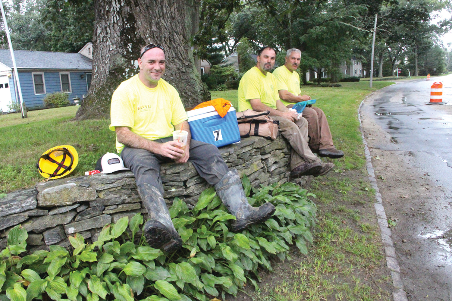 TIME FOR A BREAK: C.B. Utility workers Jeff Oliveira, John Goncalves and Sal Schiappa take some time off for lunch from their work on Gov. Francis Phase III sewers.