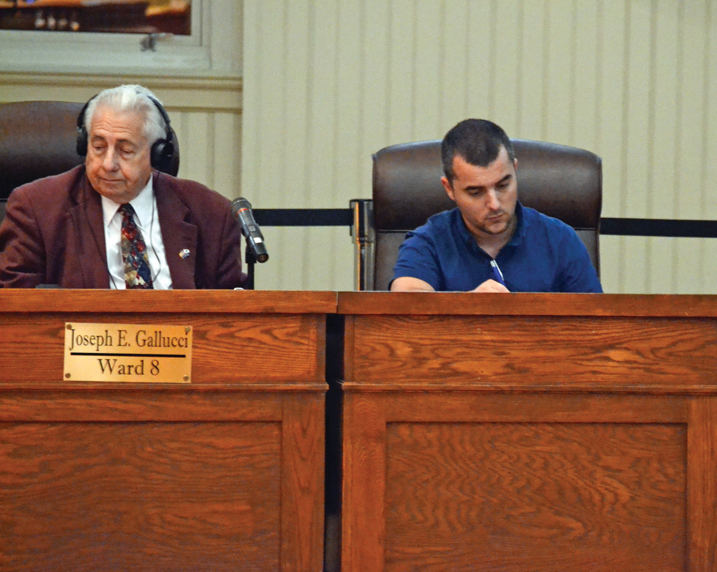 TAKING NOTES: Anthony Sinapi, newly-elected Ward 8 Councilman, sits in Steve Merolla's chair for Ward 9, next to Joseph Gallucci, whom he will replace this upcoming January.