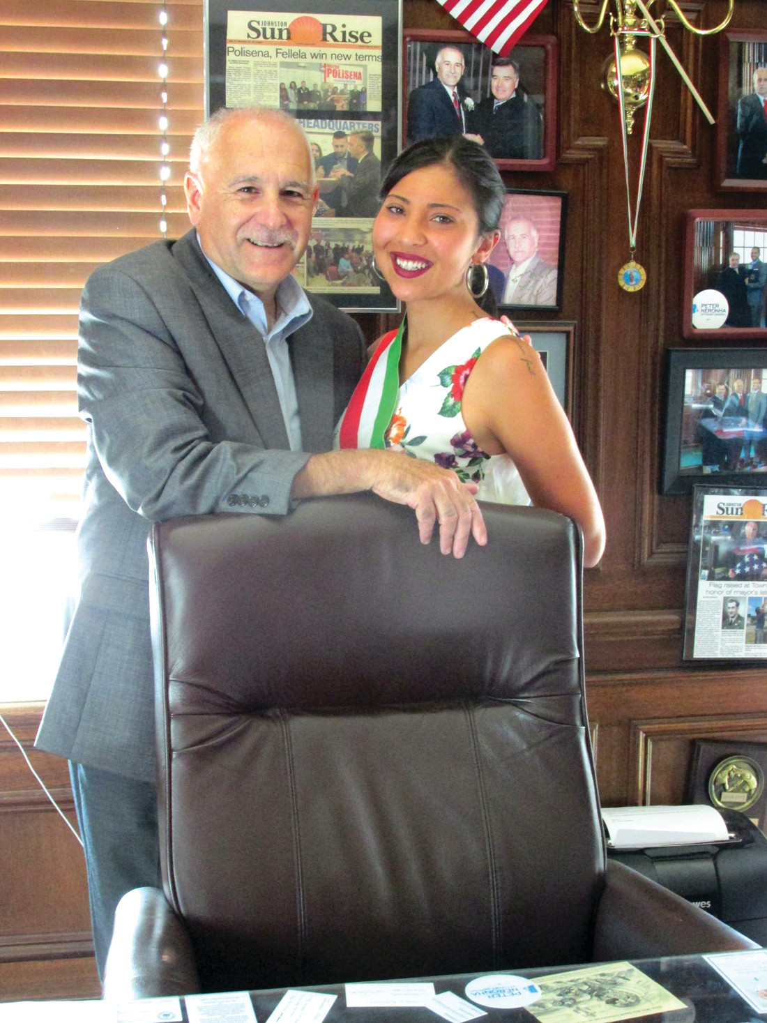 GRAND GUEST: Danida Mansolillo, the Vice Mayor of Panni, Foggia in Italy, is all smiles while joining Johnston Mayor Joseph Polisena at his desk during Monday's interesting Italian international meeting inside town hall.