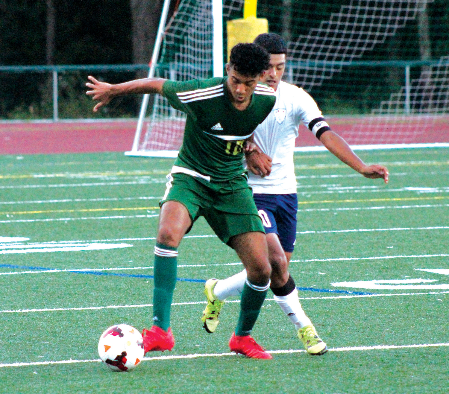 BEST FOOT FORWARD: Bishop Hendricken's Kevin Torreco works past a Shea defender.