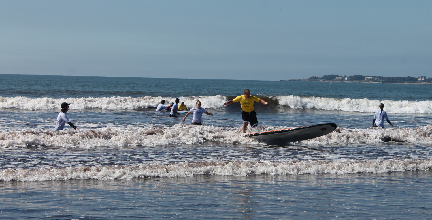 AmpSurf participant catching a wave, showing off some skills!