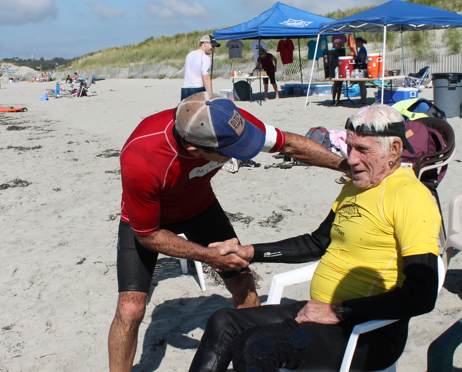 Mike Tubridy of AmpSurf congratulates Stu Stewart after a great surf on the waves.