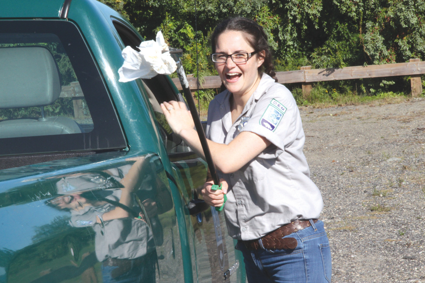 TRASH PATROL: Department of Environmental Management Park Ranger Kailegh Musto nabs a bit of trash Sunday afternoon at Rocky Point. She and two other rangers worked between Goddard and Rocky Point Sunday. They said most of the trash they find is food containers and, generally, they find that younger people are responsible for tossing it.
