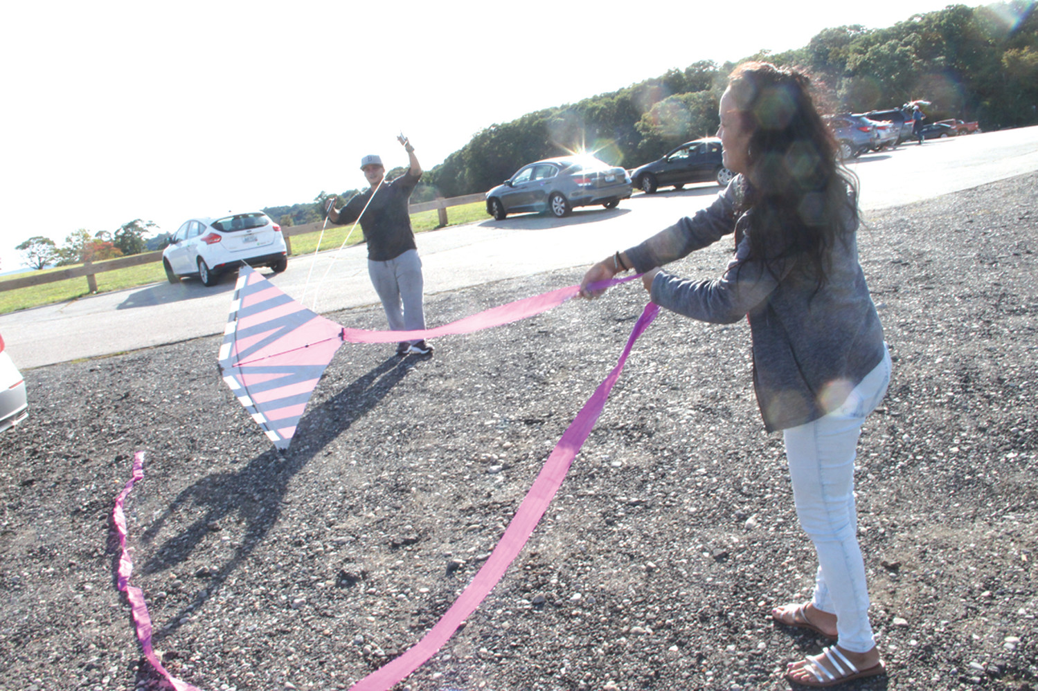 MAKING READY: Jonattan Acevedo and Mimarys Melendez prepare to fly a kite. A little more wind would have been helpful.