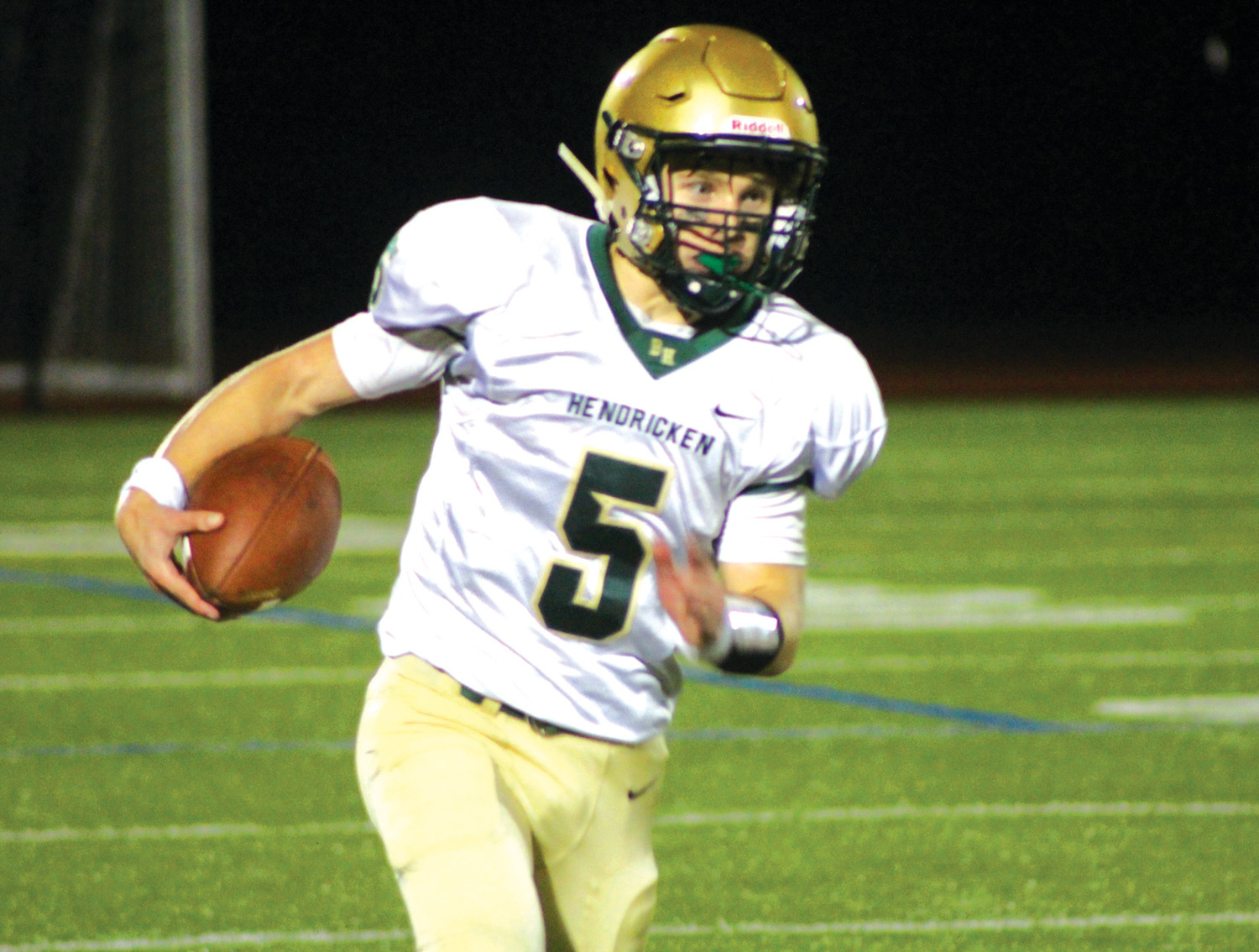 REMATCH: Bishop Hendricken quarterback Tom Comella runs against La Salle.