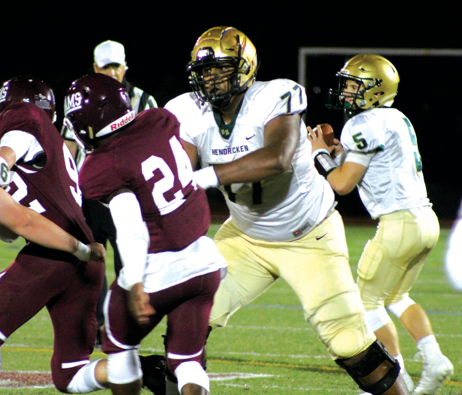 PROTECT THE QB: Hendricken's Xavier Truss.