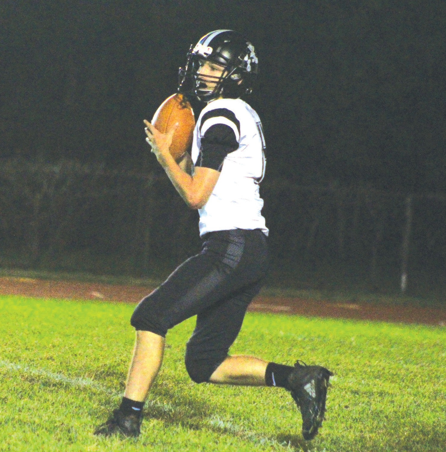 POCKET PASSER: Pilgrim's Connor Widmer drops back to pass.