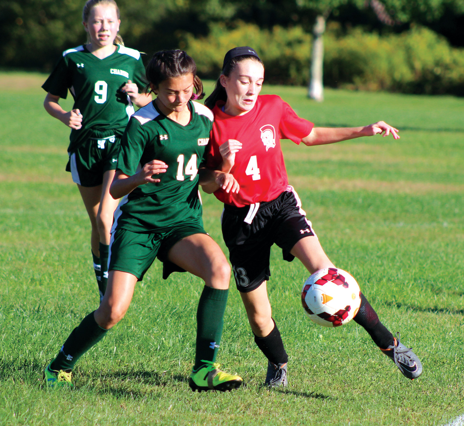 BATTLE: Winman's Alison Pankowicz fights for the ball.