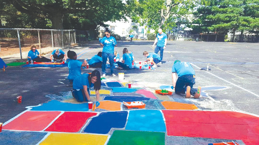 RECESS ROCKS: At Stadium Elementary School, volunteers helped to transform the outdoor blacktop space into multiple game playing areas for the students to use during recess time.
