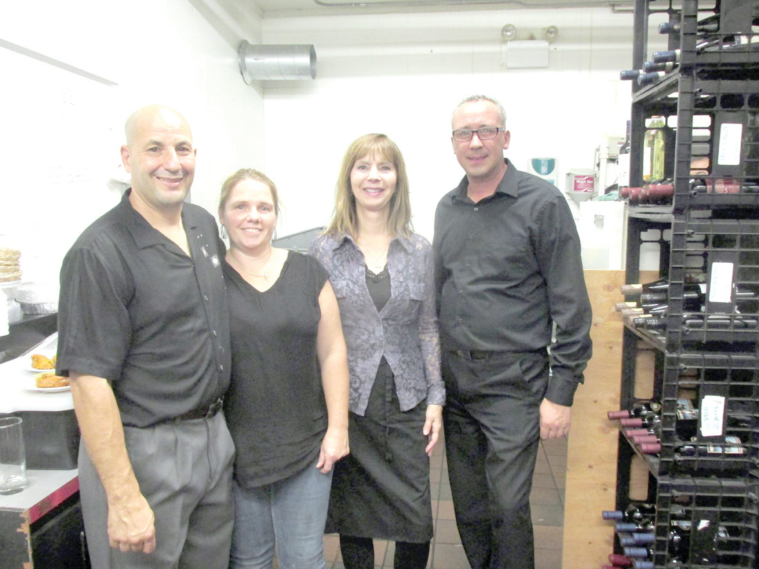 TERRIFIC TEAM: The Ave Restaurant Bar & Grill owners David and Jennifer Lombardo (left) are joined by Hostess Carol Boucher and Manager Mike Jodoin during last Friday night's official Grand Opening at 1428 Hartford Avenue.