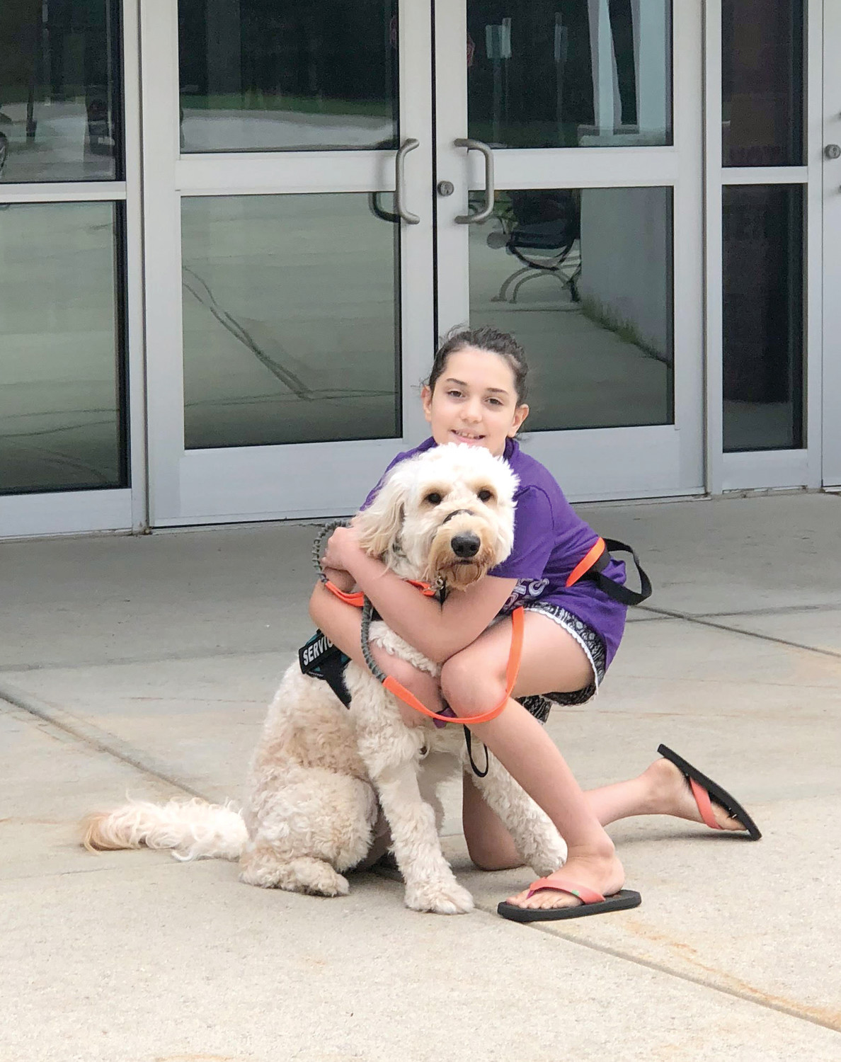 Isabella Sartini with her service dog, Biscuit.