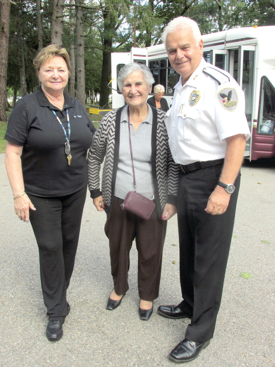 GRAND GREETING: Maria Orsini, who was born in Italy and now lives at The Bridge at Cherry Hill, received a warm welcome from Marie Conti and Johnston Police Chief Richard S. Tamburini at last week's Walk with Cops season finale.